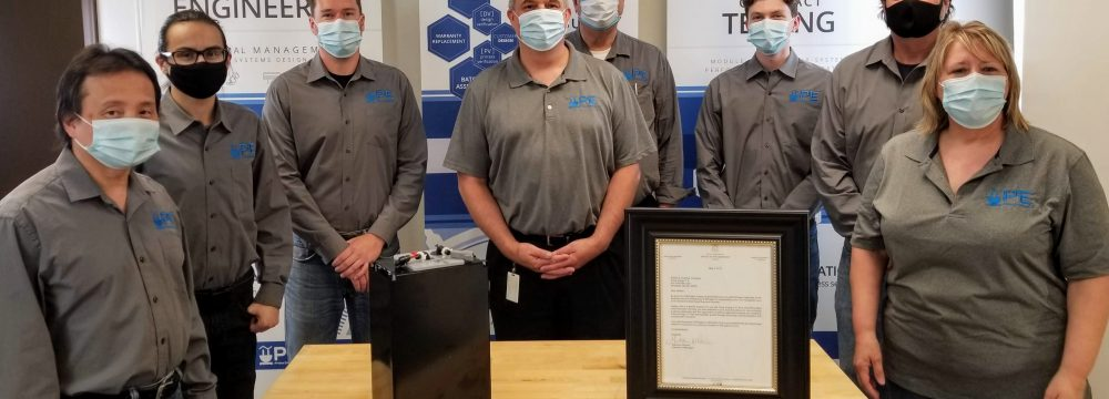 The Prime Energy Engineering team stands behind their award from the State of Michigan